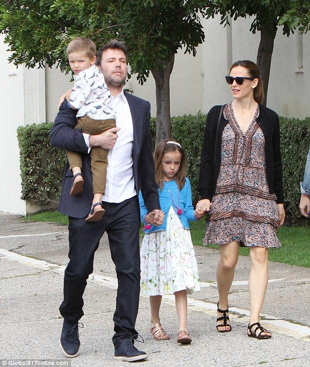 Family first: Jennifer Garner and Ben Affleck put their differences aside on Sunday to cel...