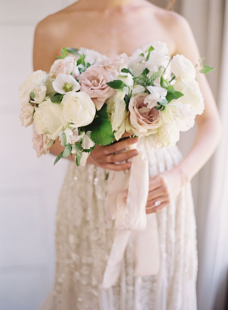 Rose and ivory wedding bouquet: Venue: Retreat at Cool Springs - http://www.stylemepretty.com/portfolio/retreat-at-cool-springs Floral Design: La Fleur Du Jour - http://www.stylemepretty.com/portfolio/la-fleur-du-jour Photography: Michael and Carina Photography - www.michaelandcarina.com Read More on SMP: http://www.stylemepretty.com/2017/06/08/neutral-toned-bridal-editorial/