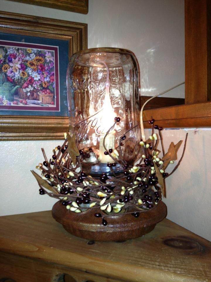 "Loved this project. Used cinnamon to ""age"" the chick feeder, added an electric candle, some berries and Voila!... A primitive lamp!"
