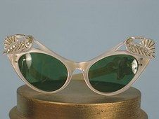Jeweled cats eye sunglasses. c 1950s, in pearlized pale pink plastic  with carved doves inset with rhinestones.