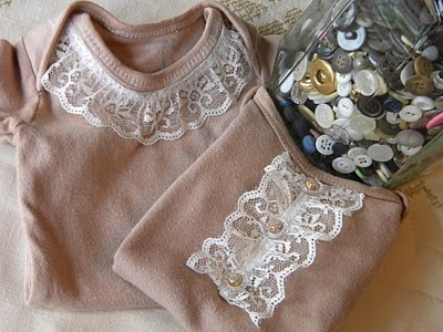 solution for stained onesies...tea dye them and pair with simple lace and buttons, cute!