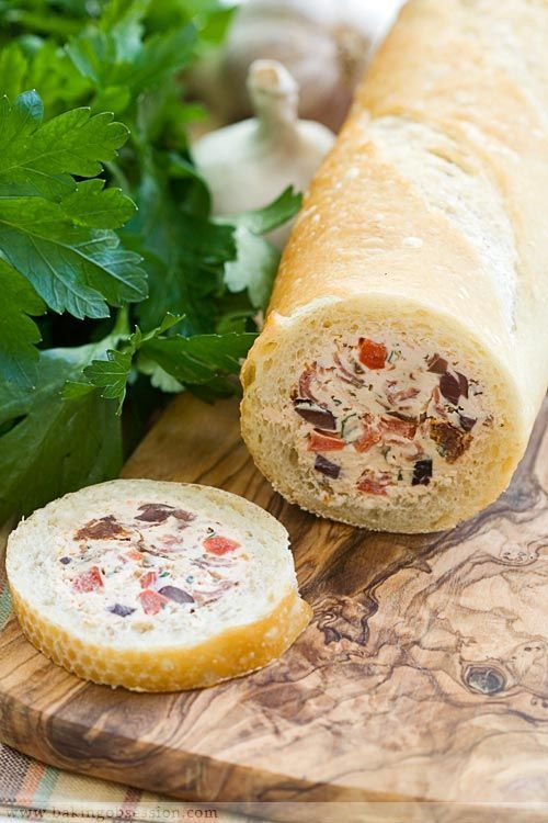 Stuffed baguette: Slice off both ends of the baguette. Using a long thin knife and working from the both ends, hollow the baguette out leaving about ½-inch thick crust all around. Fill with goat cheese/cream cheese, sun dried tomatoes, olives, spicy salami, crunchy bell pepper, and fresh herbs! I would use spinach dip also.