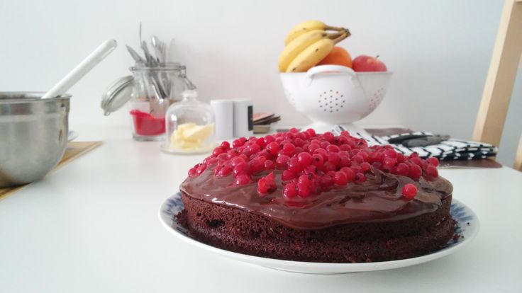The most chocolate cake with chocolate ganache and redcurrant