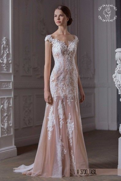 Romantic and elegant Tasil dress in soft off white and champagne colour info@michelangela.co.za