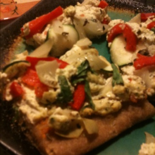 Artichoke and zucchini pizza with tofu ricotta cheese... Also has bell ...
