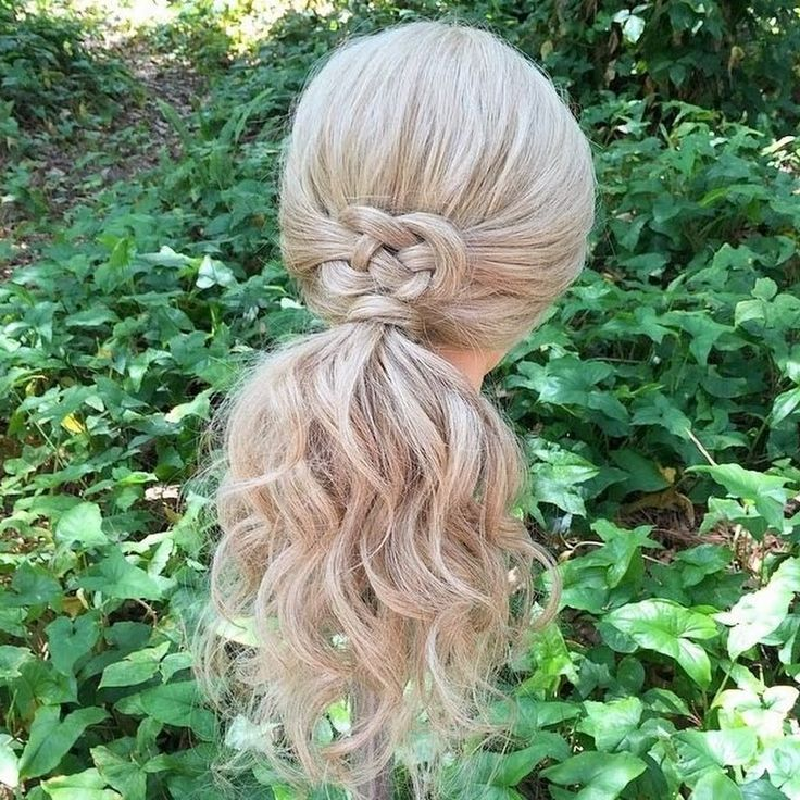This hairstyle is about a simple pony accented by a pretty knot. Recreate it for a special occasion by following the steps in the how to.