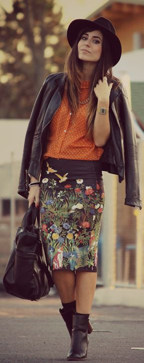 Graphic floral pencil skirt + orange blouse + black leather biker + black  ankle boots +