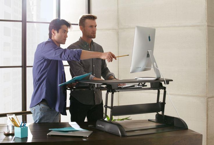 The VARIDESK adjustable height desk makes collaboration very easy