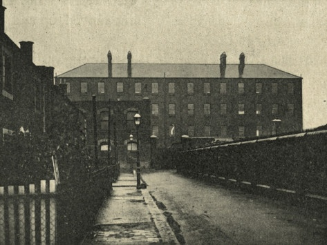 East London street. An old workhouse looms in the distance. When the poor entered the workhouses, families would be separated, many never to see one another again. I cannot imagine ever being separated from my children.