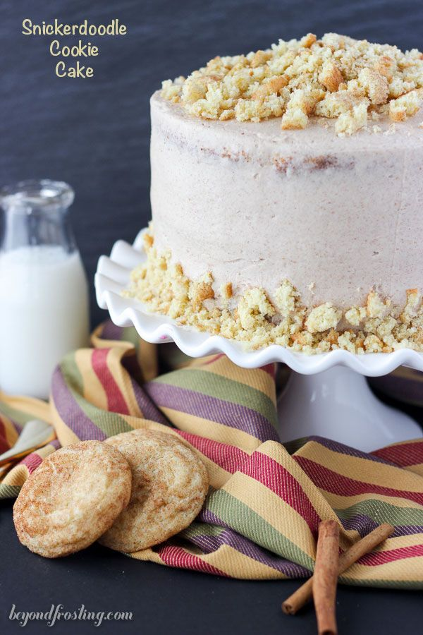 This Snickerdoodle Cookie Cake is three glorious layers of vanilla cake swirled…