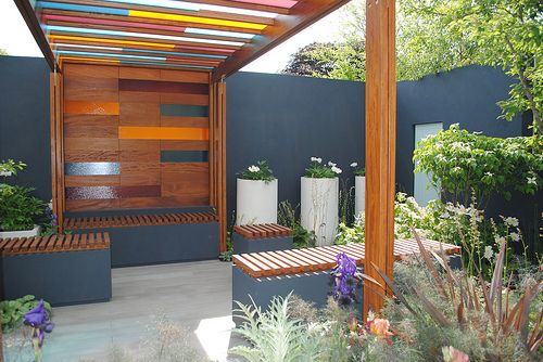 This garden pergola caught my eye for the colorful glass and wood details that it presents. I am betting that this rather simple idea for changing up the average arbor will not only provide shade and structure but interesting shadows and colorful light patterns…the white-ish stone floor probably shows this off well.