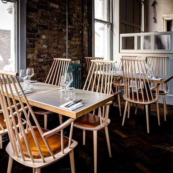 The history of the establishment remains in its aesthetic, with ancient exposed brickwork and large sash windows sitting alongside modern interiors of high-backed wooden Hay chairs, Lee Broom lighting, and a feature marble bar joining the kitchen to the petite dining room...