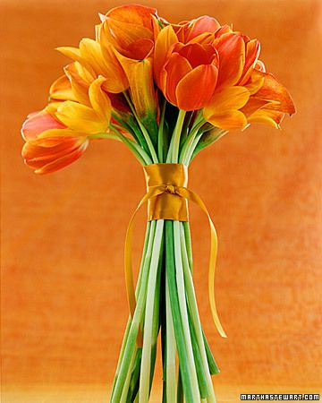 Long-stemmed tulips and calla lilies in shades of orange and tangerine. #flowers #orange