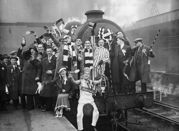 Arsenal fans at Kings Cross station en route to Grimsby for the 1936 FA Cup semifinal against Grimsby Town / LONDON