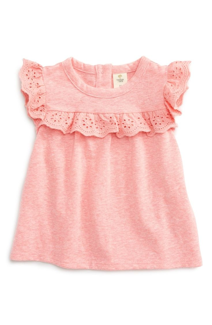 A darling eyelet-lace ruffle darts across the yoke and makes up the cap sleeves of this bright heathered tee.