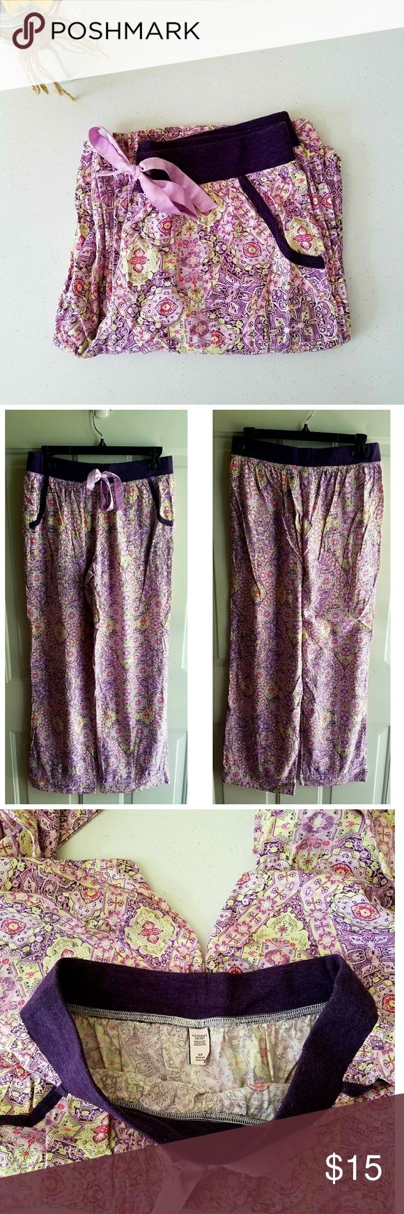 """Victoria Secret Sleep Pant Gently worn. Lite weight PJ pants with adjustable ribbon tie waist. Purple with pink, yellow, and white. Has pockets. Wide leg bottoms.  Minor flaw: Small rip in the material on the inside of the waist band see last photo. Price reflects flaw. 56% cotton and 44% modal. Machine wash.  Measurements  Length 39""""  Inseam 29.5""""  Waist 26"""" - 27""""  Hip 36.5"""" - 37.5""""  Thigh 21.25"""" - 22"""" Victoria's Secret Intimates & Sleepwear Pajamas"""