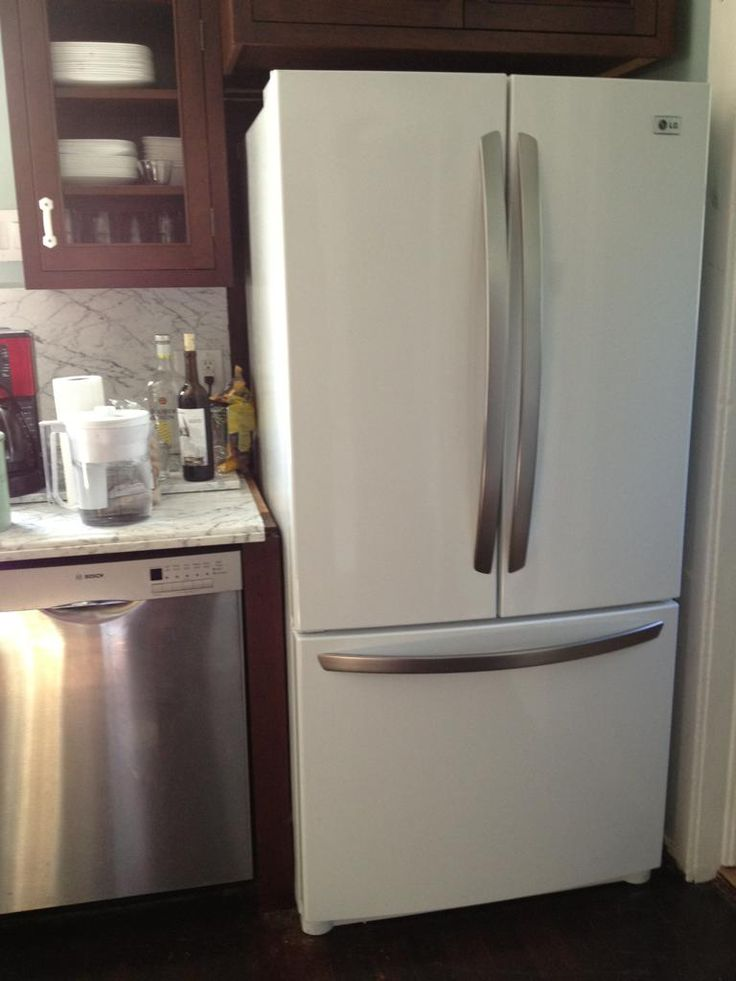 white refrigerator with stainless handles