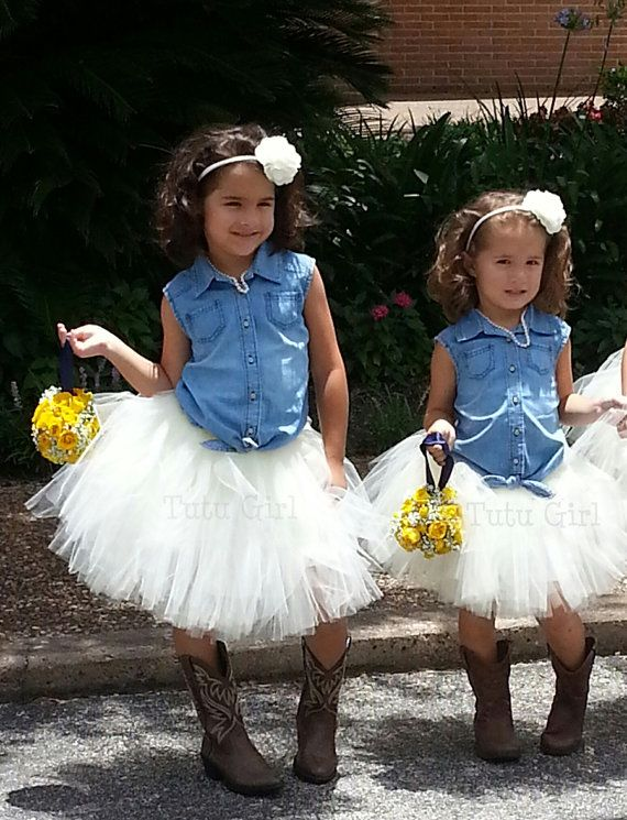 In this ivory tutu skirt your little cowgirl feels like a princess. The l ...