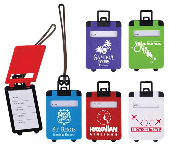 Suitcase Shaped Luggage Tags. Identify your luggage quickly and easily while showing your brand!  Shaped like a suitcase on wheels this durable hard plastic with flip-open cover reveals full ID label with name visible through view window. Sturdy strap loop included.