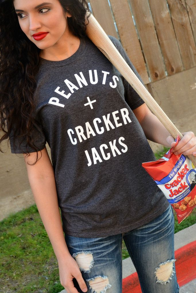 """Our Peanuts And Cracker Jacks Tee is a LaRue Exclusive and features a super soft charcoal tee with the phrase """"Peanuts + Cracker Jacks"""" in white. Made of 50% Cotton and 50% Polyester. Model is a size"""