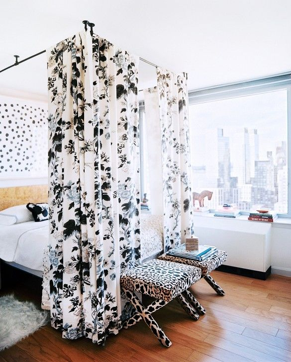 By screwing black piping to the ceiling, it's easy to hang dramatic panels of fabric.