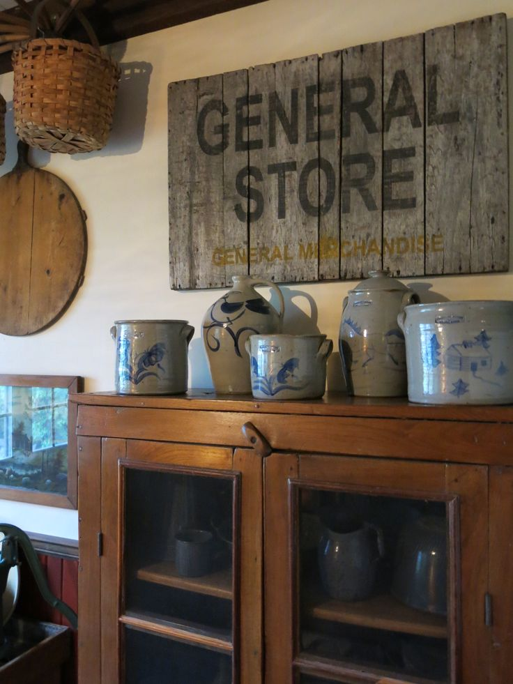 Stoneware crocks - love the old sign too!