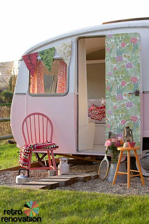 Cute little camper trailer garden cottage - love the vintage wallpaper on the door!