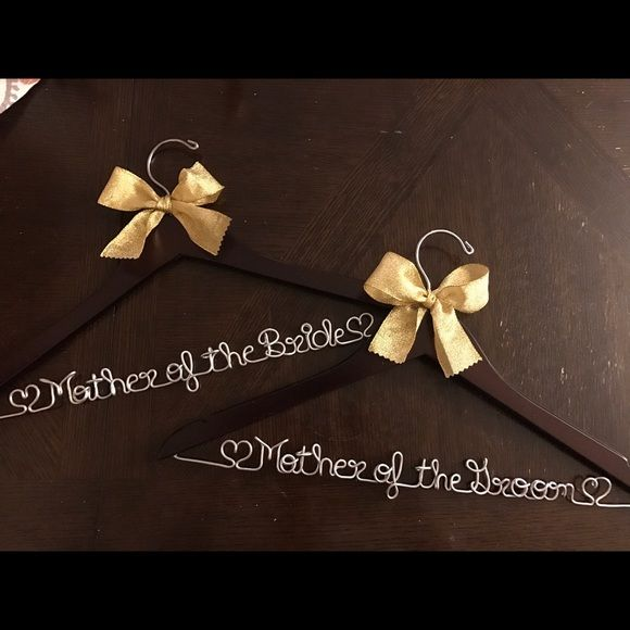 Shop Women's Got Joy Gifts Brown size Various Accessories at a discounted price at Poshmark. Description: Special listing order: Dark walnut wood, Gold ribbons, names: Mother of the Bride, Mother of the Groom, Bride Don't forget a personalized hanger to show off your gorgeous wedding gown! I can custom design a hanger for the bride, bridesmaids, flower girl, or other members of the wedding party. I recommend to keep these hangers stored in a box until time to use to protect the wire...