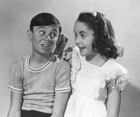 """Carl """"Alfalfa"""" Switzer from """"Our Gang"""" and Elizabeth Taylor 1942. WOW what a moment for alfalfa!!"""
