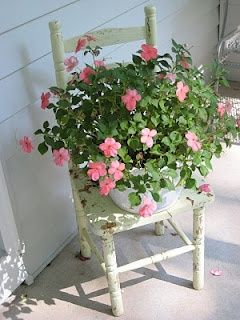 Front porch decorating…I have an old chair... Change out the plant with the seasons...