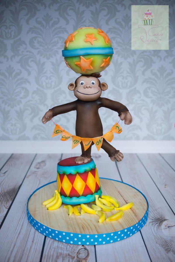 Curious George cake circus balance cake