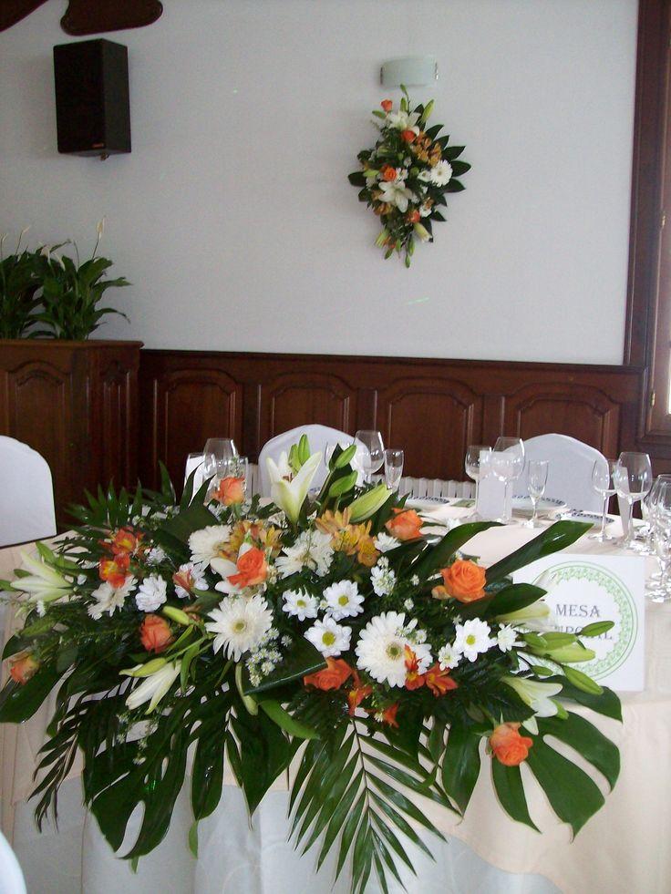 Arreglo mesa y detalle pared o xardín arte floral