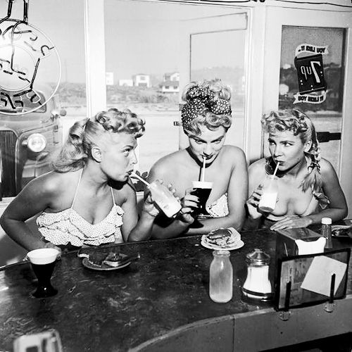 Women at a beach-front soda fountain, c. 1940s.