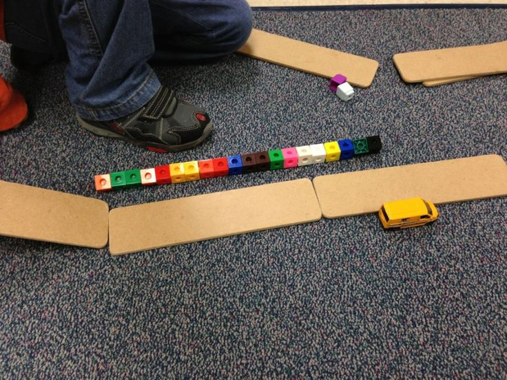 Exploring force and motion by building ramps. The kids measure how far the cars roll with cubes. Great science and math activity that is FUN!