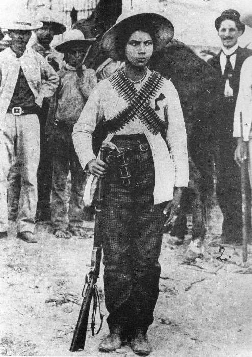 A soldadera of the Mexican Revolution. Her name was Valentina Ramirez she was a Colonel and Pancho Villa's Love. She's my 2nd cousin's great grandmother