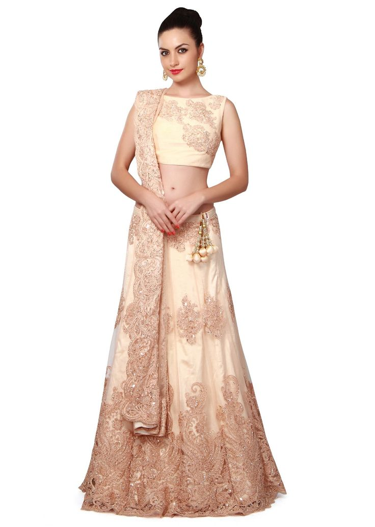 Cream lehenga featuring in net.  Its enhanced in resham and kardana embellished butti.  Blouse is in embroidered silk.  Matched with net dupatta.  Slight variation in color is possible.  95% of our customers believe that the product is as shown on the website.