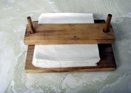 """Napkin Holder, for camping so the napkins don't blow away. The base is 6.5 X 8.5 and the top piece is 2 X 8.5. The dowels are 1/4"""", spaced 7.25 center to center. Holes in the top piece, where the dowels slide through, are 5/16. Material was 1X pine, although any type of 1X would work fine of course. I don't see any reason a 1X8 could not be used for the base and left full width."""
