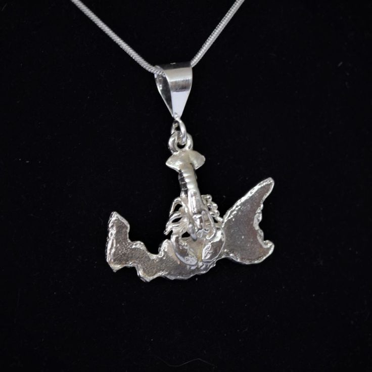 Product Description Sterling silver lobster and PEI pendant. This piece is handcrafted at our Georgetown  PEI studio.  60 dollars