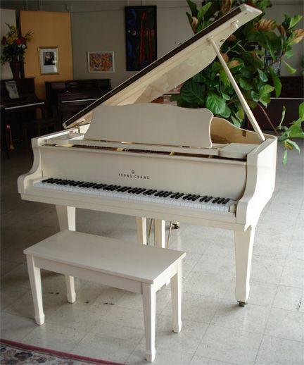 A white grand piano. http://pinterest.com/cameronpiano