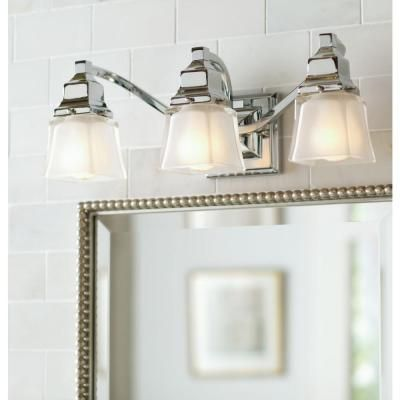 The Home Depot- Hampton Bay 3-Light Chrome Bath Light-05660 - 7''D, 7''H, 18.75''W; E26 base, 100W each; $99.97  (**looked yellow at the store - would need to confirm it was white)
