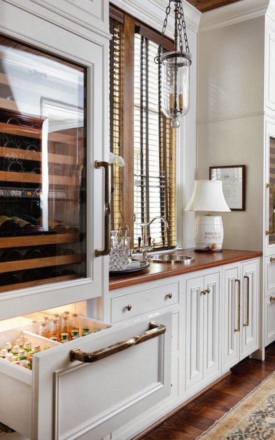 Design Chic: Kitchen Organization - love it all, but especially the beverage fridge and the recessed space by the stove for essentials