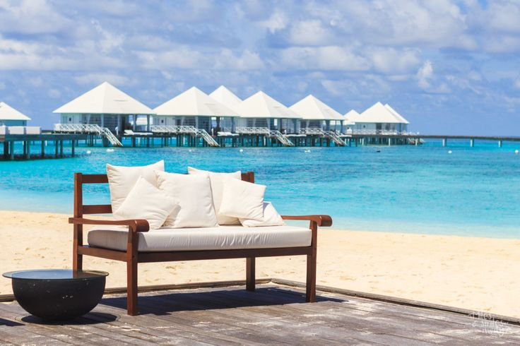 All white villa at Diamonds Thufushi in Maldives. Great combination with the cobalt blue sea.