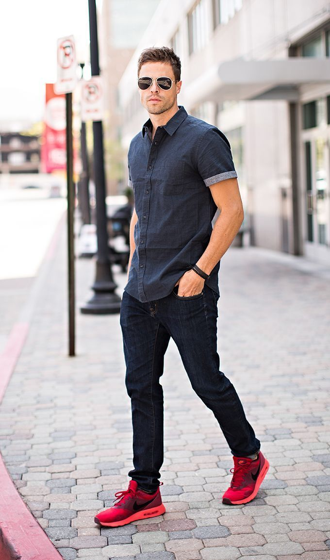 Consider wearing a charcoal short sleeve shirt and black slim jeans for an easy to wear, everyday look. A pair of red sneakers brings the dressed-down touch to the ensemble.   Shop this look on Lookastic: https://lookastic.com/men/looks/short-sleeve-shirt-skinny-jeans-athletic-shoes-sunglasses-bracelet/12662   — Dark Brown Sunglasses  — Red Athletic Shoes  — Black Skinny Jeans  — Black Bracelet  — Charcoal Short Sleeve Shirt