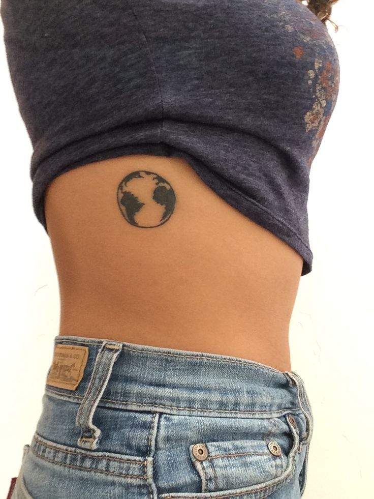Tattoo on side of a planet earth