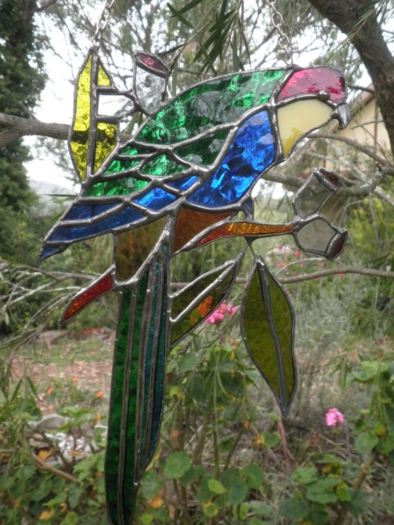VOLCANIA ART GLASS GALLERY. Stained glass / leadlight red capped parrot by Volcania Art Glass Gallery in the old garage workshop next to Cafe Nundle. Think of the TV show - Grand Designs.