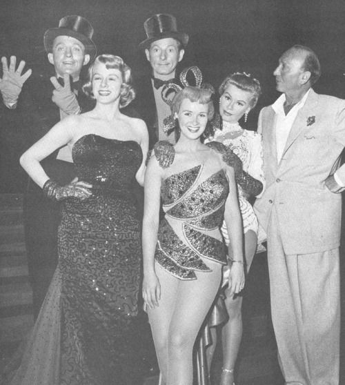 The cast of White Christmas with director Michael Curtiz.