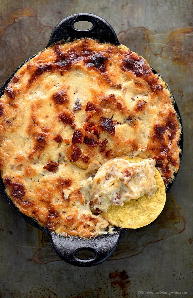This Baked Bacon Cheese Onion Dip Recipe made with crispy bacon, gooey Gruyere, and caramelized onions is sure to please a crowd at any party or gathering.   shewearsmanyhats.com