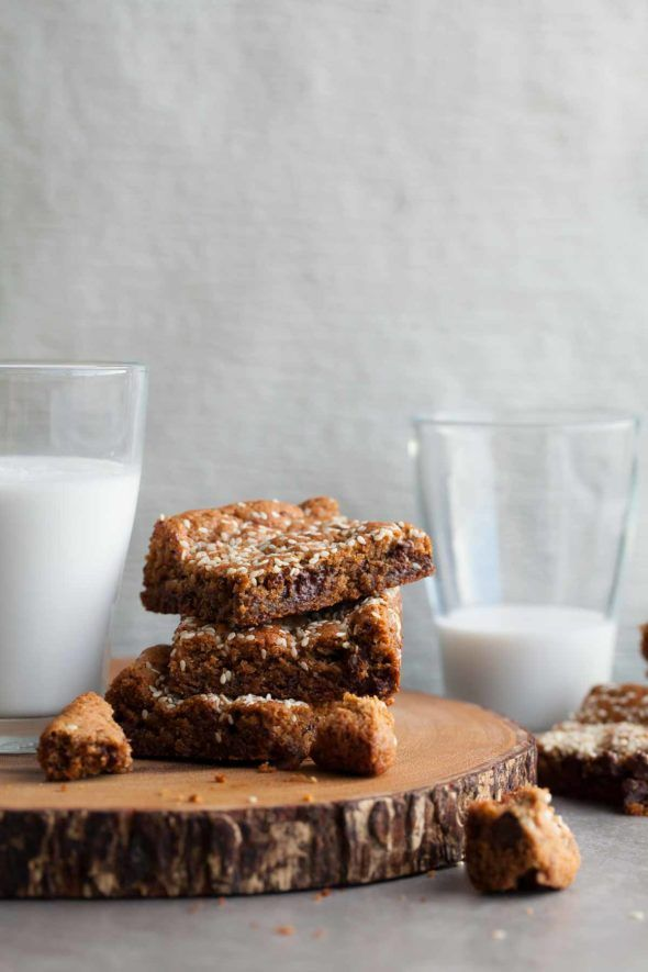 Tahini Almond Blondies (Gluten-Free, Paleo) // These nutty and rich gluten-free, paleo tahini almond blondies are bursting with chunks of chocolate on the inside and toasted sesame seeds on top. // @gourmandeinthek