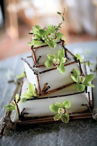 Bamboo and orchids cake... if I saw this a year and a half ago, this would've been my wedding cake for sure! gorgeous simplicity!