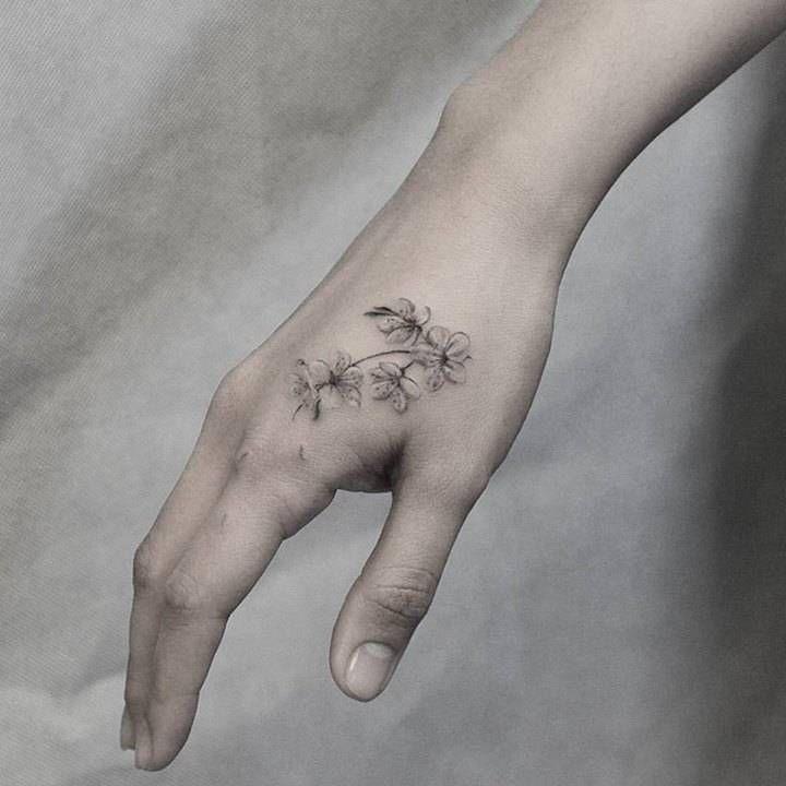 Fine Line Style Cherry Blossoms Tattoo On The Right Hand Tattoo Artist Kane Navasard Hand Tattoos Small Hand Tattoos Blossom Tattoo
